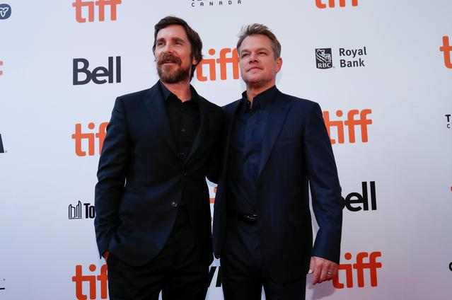 """Actors Matt Damon and Christian Bale pose as they arrive at the international premiere of """"Ford V Ferrari"""" at the Toronto International Film Festival (TIFF) in Toronto, Ontario, Canada September 9, 2019.  REUTERS/Mario Anzuoni"""