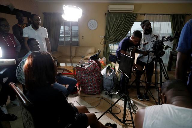 FILE PHOTO: Crew members film a scene on the set of a ROK's film in Lagos, Nigeria July 21, 2019. REUTERS/Temilade Adelaja