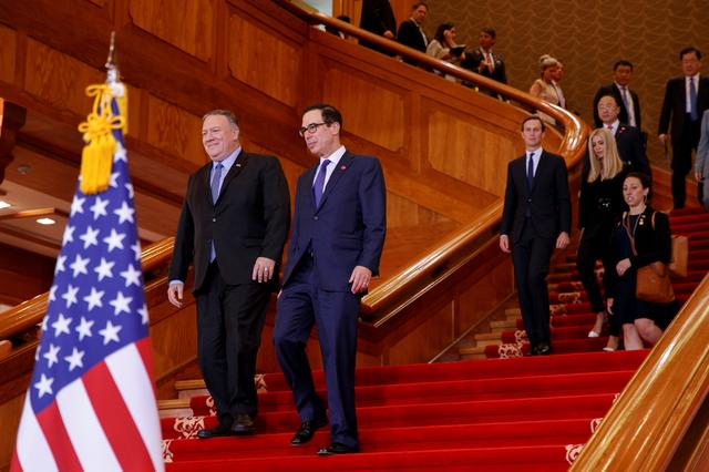FILE PHOTO - Secretary of State Mike Pompeo, left, walks with Treasury Secretary Steve Mnuchin as they are followed by White House Advisers Jared Kushner and Ivanka Trump, as they arrive for a news conference by President Donald Trump and South Korean President Moon Jae-in, at Blue House, in Seoul, South Korea, Sunday, June 30, 2019, before heading to the Demilitarized Zone.  Photo taken June 30, 2019.   Jacquelyn Martin/Pool via REUTERS