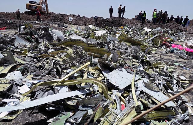FILE PHOTO -Wreckage is seen at the site of the Ethiopian Airlines Flight ET 302 plane crash, near the town of Bishoftu, southeast of Addis Ababa, Ethiopia March 11, 2019. REUTERS/Tiksa Negeri
