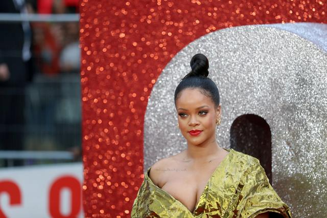 FILE PHOTO: Cast member Rihanna poses for pictures on the red carpet for the European premiere of Ocean's 8 in London, Britain June 13, 2018. REUTERS/Simon Dawson