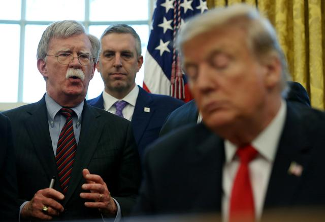 FILE PHOTO: U.S. President Donald Trump listens as his national security adviser John Bolton speaks during a presidential memorandum signing for the Women's Global Development and Prosperity initiative in the Oval Office at the White House in Washington, U.S., February 7, 2019. REUTERS/Leah Millis