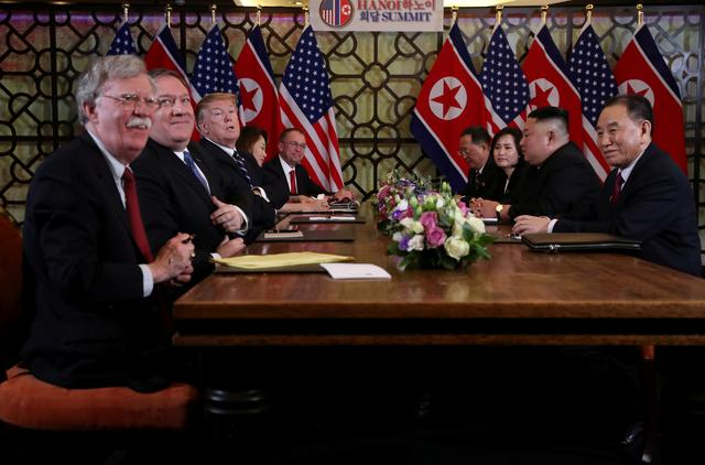 FILE PHOTO: North Korea's leader Kim Jong Un and U.S. President Donald Trump attend the extended bilateral meeting in the Metropole hotel with U.S. Secretary of State Mike Pompeo, White House national security adviser John Bolton, acting White House Chief of Staff Mick Mulvaney, North Korean Foreign Minister Ri Yong Ho and Kim Yong Chol, Vice Chairman of the North Korean Workers' Party Committee, during the second North Korea-U.S. summit in Hanoi, Vietnam February 28, 2019. REUTERS/Leah Millis/File Photo