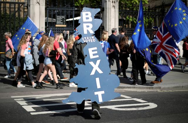 FILE PHOTO: A pro-Brexit supporter is seen outside Parliament in London, Britain, June 17, 2019. REUTERS/Hannah McKay