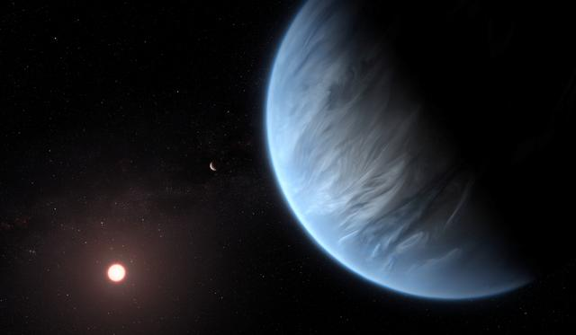 An artist's impression released by NASA on September 11, 2019 shows the planet K2-18b, its host star and an accompanying planet. Courtesy ESA/Hubble/M. Kornmesser/NASA Handout via REUTERS
