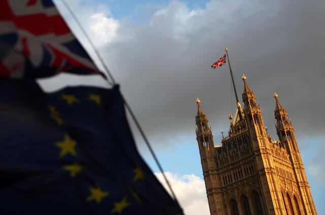 Flags flutter outside the Houses of Parliament, in London, Britain, September 4, 2019. REUTERS/Hannah McKay