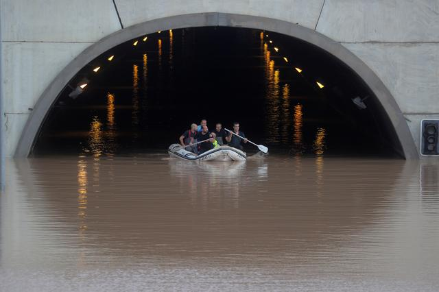 Rescue workers on a boat rescue a person stranded inside a flooded tunnel after heavy floods in Pilar de la Horadada, Spain, September 13, 2019. REUTERS/Sergio Perez