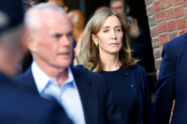 Actress Felicity Huffman leaves the federal courthouse with her husband William H. Macy, after being sentenced in connection with a nationwide college admissions cheating scheme in Boston, Massachusetts, U.S., September 13, 2019.  REUTERS/Katherine Taylor