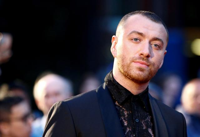 FILE PHOTO: Singer Sam Smith poses as they arrive to the GQ Men Of The Year Awards 2019 in London, Britain September 3, 2019. REUTERS/Henry Nicholls