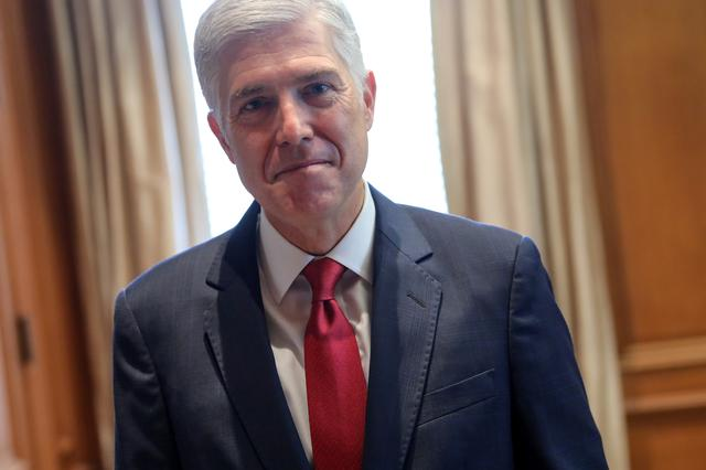 U.S. Supreme Court Justice Neil Gorsuch poses for a picture in his chambers at the Supreme Court building in Washington, U.S. September 13, 2019.  REUTERS/Jonathan Ernst
