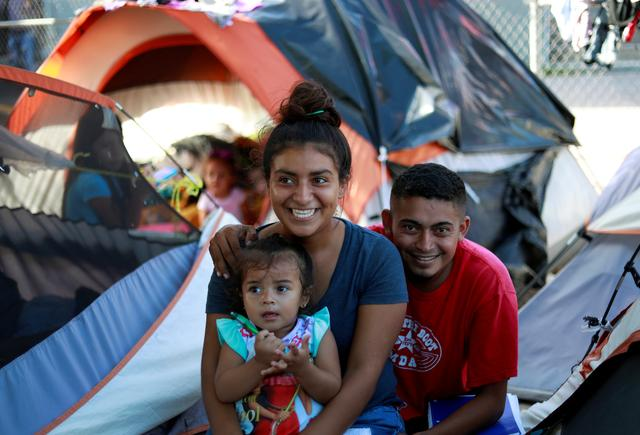 "Honduran migrants Marvin Madrid and his new wife Dexy Maldonado speak during an interview with Reuters in an encampment in Matamoros, Mexico, at the end of the Gateway International Bridge, where migrants sent back under the ""Remain in Mexico"" program, officially called the MIgrant Protection Protocols (MPP), await their U.S. asylum hearings, September 13, 2019.  REUTERS/Henry Romero"
