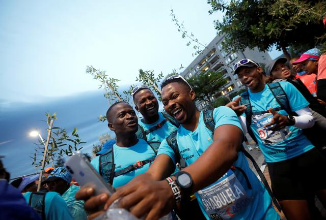 Activist and treegrower Siyabulela Sokomani takes a selfies as he prepares for the start of the Cape Town marathon, in South Africa September 15, 2019. REUTERS/Mike Hutchings