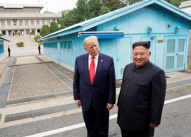 FILE PHOTO: U.S. President Donald Trump meets with North Korean leader Kim Jong Un at the demilitarized zone separating the two Koreas, in Panmunjom, South Korea, June 30, 2019. REUTERS/Kevin Lamarque/File Photo/File Photo
