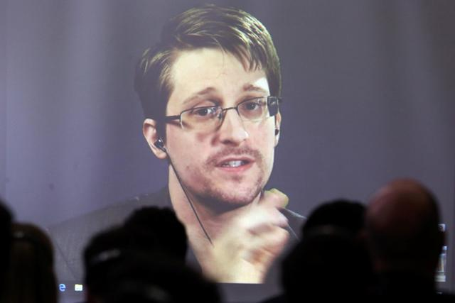 FILE PHOTO: Edward Snowden speaks via video link during a conference at University of Buenos Aires Law School, Argentina, November 14, 2016. REUTERS/Marcos Brindicci