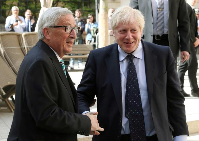 British Prime Minister Boris Johnson shakes hands with European Commission President Jean-Claude Juncker during a meeting in Luxembourg, September 16, 2019. REUTERS/Yves Herman