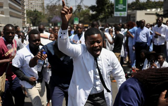 Doctors sing and hold placards during a protest over the disappearance of the leader of their union in Harare, Zimbabwe, September 14, 2019. REUTERS/Siphiwe Sibeko