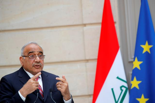 FILE PHOTO: Iraqi Prime Minister Adel Abdul Mahdi delivers a joint statement with French President Emmanuel Macron (not seen) at the Elysee Palace in Paris, France, May 3, 2019.  REUTERS/Philippe Wojazer/Pool