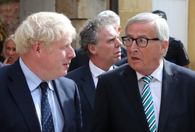 British Prime Minister Boris Johnson and European Commission President Jean-Claude Juncker talk as they leave after their meeting in Luxembourg, September 16, 2019. REUTERS/Yves Herman