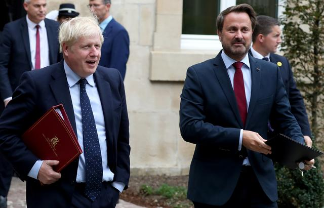 Luxembourg's Prime Minister Xavier Bettel and British Prime Minister Boris Johnson leave after a meeting in Luxembourg, September 16, 2019. REUTERS/Yves Herman