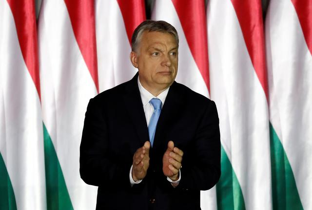 Hungarian Prime Minister Viktor Orban applauds as he presents the programme of his Fidesz party for European Parliament elections in Budapest, Hungary April 5, 2019. REUTERS/Bernadett Szabo