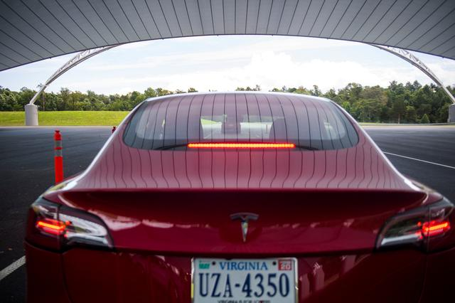 FILE PHOTO: Joe Young, media relations associate for the Insurance Institute for Highway Safety (IIHS), demonstrates a front crash prevention test on a 2018 Tesla Model 3 at the IIHS-HLDI Vehicle Research Center in Ruckersville, Virginia, U.S., July 22, 2019. REUTERS/Amanda Voisard - RC1754ACA7E0/File Photo