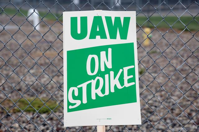 A United Auto Workers (UAW) picket sign is seen outside General Motors Powertrain Flint Engine plant during the UAW national strike in Flint, Michigan, U.S. September 16, 2019.  REUTERS/Rebecca Cook
