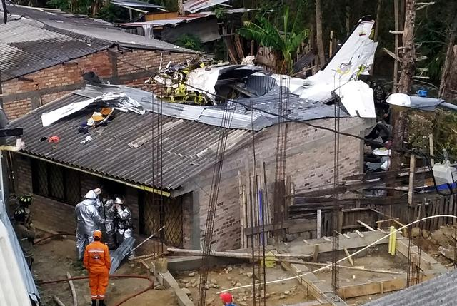 Rescue crews work in the wreckage from a plane that crashed into a house in Popayan, Colombia September 15, 2019. REUTERS/Francisco Calderon