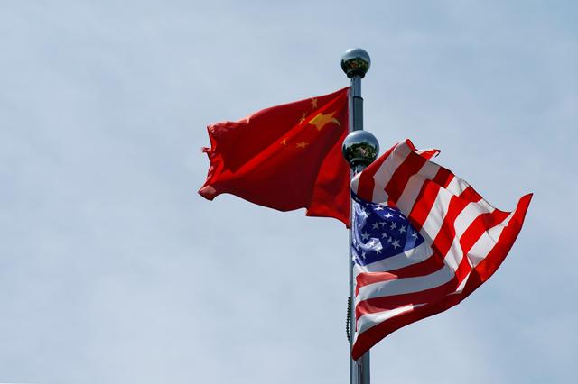 FILE PHOTO: Chinese and U.S. flags flutter near The Bund, before U.S. trade delegation meet their Chinese counterparts for talks in Shanghai, China July 30, 2019. REUTERS/Aly Song/File Photo/File Photo