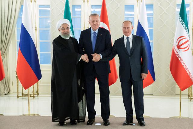 Presidents Hassan Rouhani of Iran, Tayyip Erdogan of Turkey and Vladimir Putin of Russia shake hands during their meeting in Ankara, Turkey, September 16, 2019. Pavel Golovkin/Pool via REUTERS