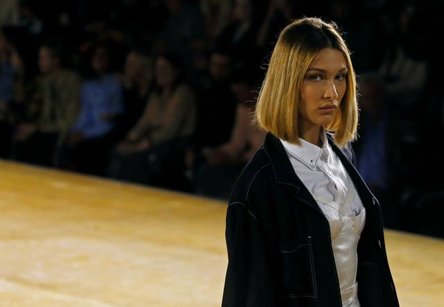 Model Bella Hadid presents a creation during the Burberry catwalk show at London Fashion Week in London, Britain, September 16, 2019. REUTERS/Henry Nicholls