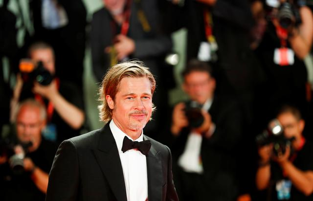 "FILE PHOTO: The 76th Venice Film Festival - Screening of the film ""Ad Astra"" in competition - Red Carpet Arrivals - Venice, Italy, August 29, 2019 - Actor Brad Pitt poses. REUTERS/Yara Nardi"