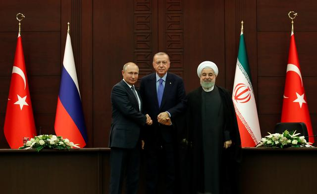 Presidents Vladimir Putin of Russia, Tayyip Erdogan of Turkey and Hassan Rouhani of Iran pose following a joint news conference in Ankara, Turkey, September 16, 2019. REUTERS/Umit Bektas