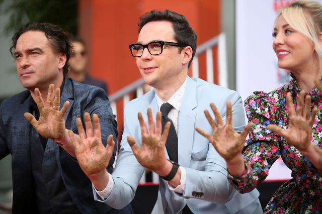 "FILE PHOTO - Actors Johnny Galecki, Jim Parsons and Kaley Cuoco participate in the cement handprints ceremony for the cast of the television comedy ""The Big Bang Theory"" at the TCL Chinese Theatre IMAX in Hollywood, Los Angeles, California, U.S., May 1, 2019. REUTERS/Danny Moloshok"