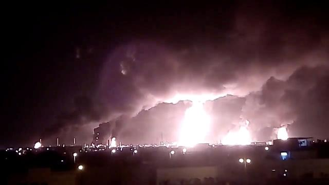 FILE PHOTO: Fires burn in the distance after a drone strike by Yemen's Iran-aligned Houthi group on Saudi company Aramco's oil processing facilities, in Buqayq, Saudi Arabia September 14, 2019 in this still image taken from a social media video obtained by REUTERS