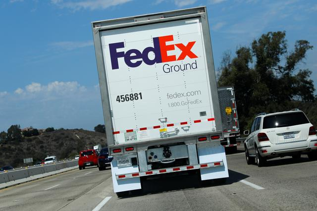 FILE PHOTO: A Federal Express Ground truck travels down a highway through Carlsbad, California, U.S., September 16, 2019.    REUTERS/Mike Blake