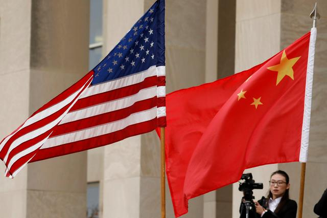 FILE PHOTO: U.S. and Chinese flags are seen before Defense Secretary James Mattis welcomes  Chinese Minister of National Defense Gen. Wei Fenghe to the Pentagon in Arlington, Virginia, U.S., November 9, 2018. REUTERS/Yuri Gripas