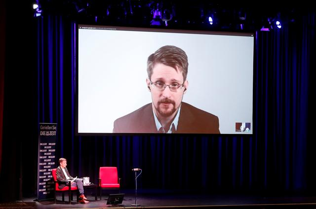 """Edward Snowden speaks via video link as he takes part in a discussion about his book """"Permanent Record"""" with German journalist Holger Stark in Berlin, Germany, September 17, 2019. REUTERS/Fabrizio Bensch"""