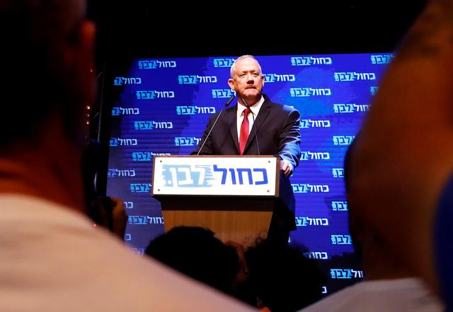 Blue and White party leader Benny Gantz speaks at the party's headquarters following the announcement of exit polls during Israel's parliamentary election in Tel Aviv, Israel September 18, 2019. REUTERS/Corinna Kern