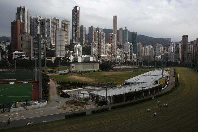 FILE PHOTO: Luxurious residential blocks are seen behind Happy Valley horse racing track in Hong Kong October 26, 2012. REUTERS/Bobby Yip