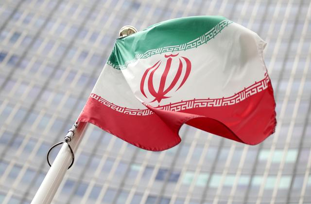 FILE PHOTO: The Iranian flag flutters in front of International Atomic Energy Agency (IAEA) headquarters in Vienna, Austria July 10, 2019.  REUTERS/Lisi Niesner/File Photo