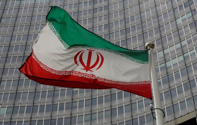 An Iranian flag flutters in front of the International Atomic Energy Agency (IAEA) headquarters in Vienna, Austria September 9, 2019.   REUTERS/Leonhard Foeger