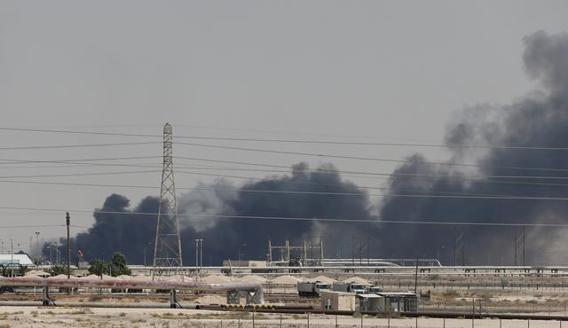 FILE PHOTO: Smoke is seen following a fire at Aramco facility in the eastern city of Abqaiq, Saudi Arabia, September 14, 2019. REUTERS/Stringer/File Photo/File Photo