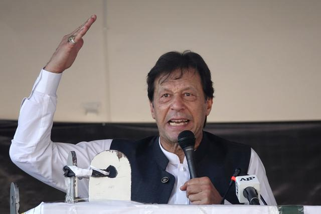Pakistan's Prime Minister Imran Khan gestures as he speaks during a rally to express solidarity with the people of Kashmir, in Muzaffarabad, Pakistan-administered Kashmir, September 13, 2019. REUTERS/Naseer Chaudary