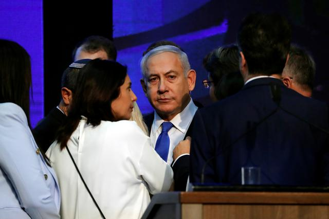 Israeli Prime Minister Benjamin Netanyahu looks on after speaking to supporters at his Likud party headquarters following the announcement of exit polls during Israel's parliamentary election in Tel Aviv, Israel September 18, 2019. REUTERS/Ammar Awad