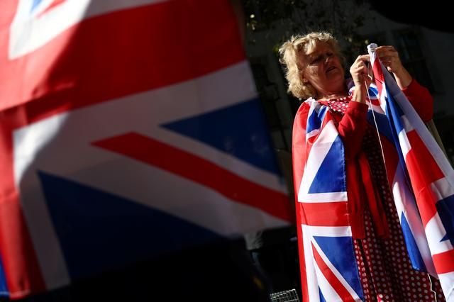 A protester, wrapped in British Union Jack flag, is seen outside the Supreme Court of the United Kingdom, in London, Britain September 18, 2019. REUTERS/Hannah McKay