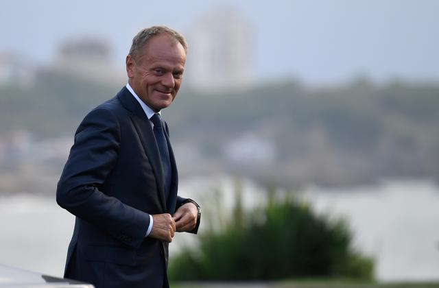 FILE PHOTO: EU Council President Donald Tusk arrives at the G7 summit in Biarritz, France, August 24, 2019. Neil Hall/Pool via REUTERS -/File Photo