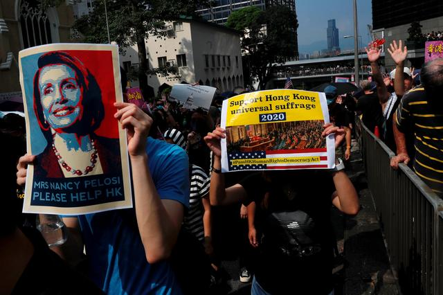 FILE PHOTO: Protesters march to call for the United States Congress to pass the Hong Kong Human Rights and Democracy Act in Hong Kong, China September 8, 2019. REUTERS/Tyrone Siu/File Photo