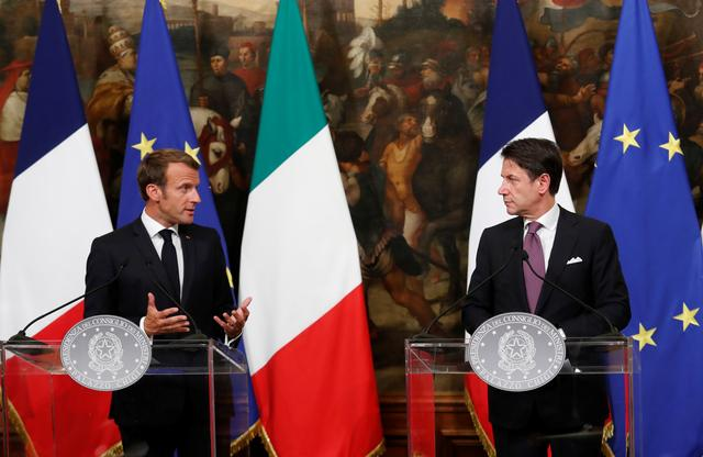 French President Emmanuel Macron speaks to the media ahead of a working dinner with Italian Prime Minister Giuseppe Conte, in Rome, Italy September 18, 2019. REUTERS/Remo Casilli