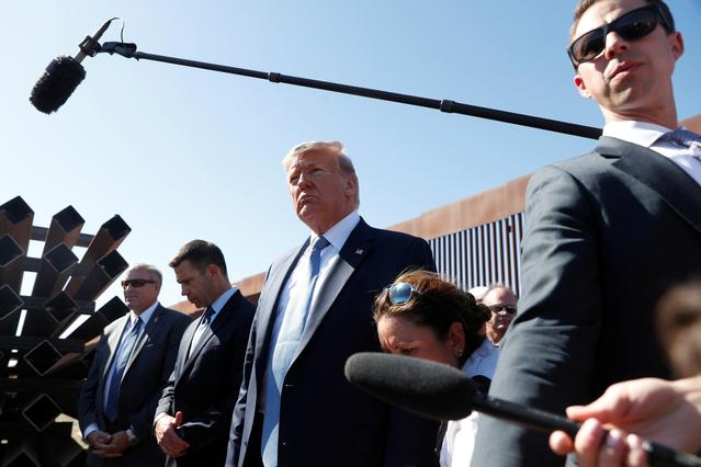 FILE PHOTO: U.S. President Donald Trump visits a section of the U.S.-Mexico border wall in Otay Mesa, California, U.S. September 18, 2019. REUTERS/Tom Brenner