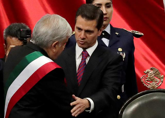 FILE PHOTO: Mexico's new President Andres Manuel Lopez Obrador is congratulated by former President Enrique Pena Nieto during his inauguration ceremony in congress, in Mexico City, Mexico December 1, 2018. REUTERS/Henry Romero